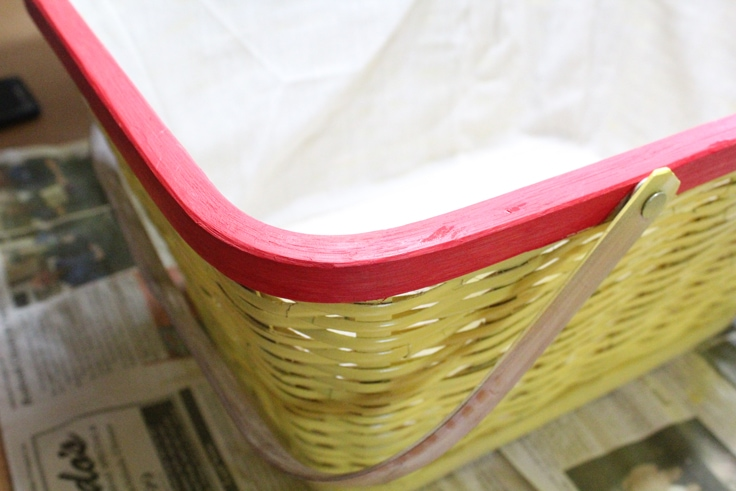 yellow picnic basket with red trim