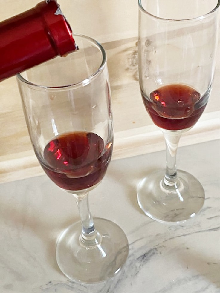 raspberry liqueur poured in glasses