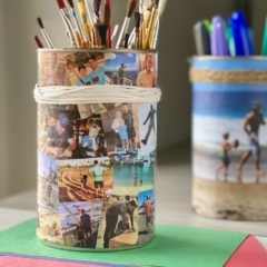 DIY collage photo caddy filled with paintbrushes; a single photo caddy in the background.