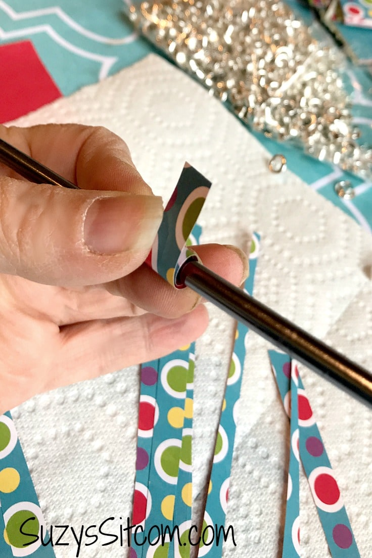 Rolling paper around a knitting needle