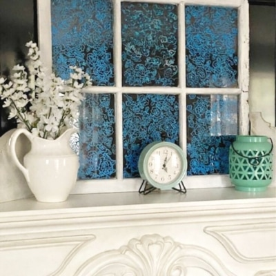 painted glass window shown on mantel