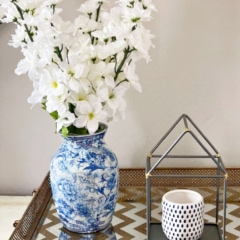 diy chinoiserie vase shown on gold tray