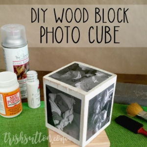 Photo cube with supplies needed to create it in the background.