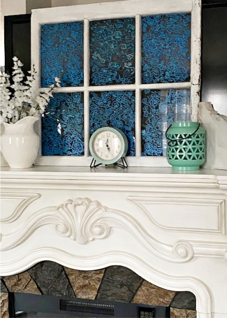 fireplace with vintage painted glass window