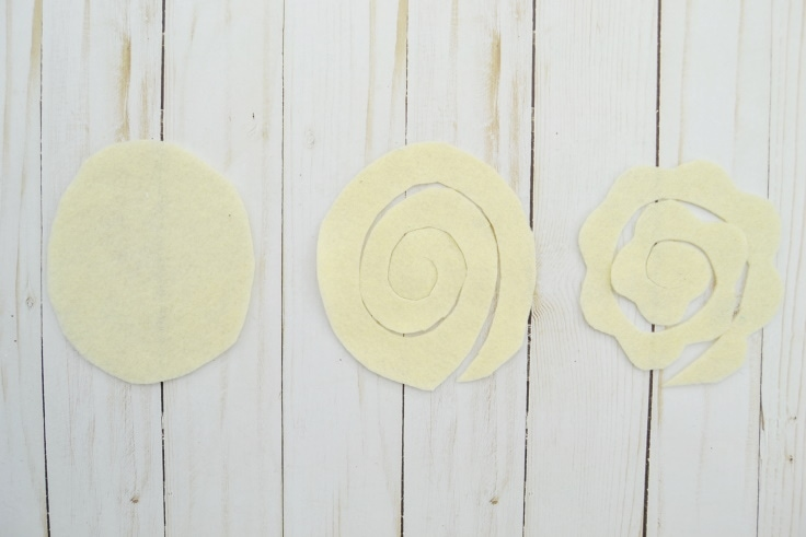 the process of making a swirled felt flower with scallops