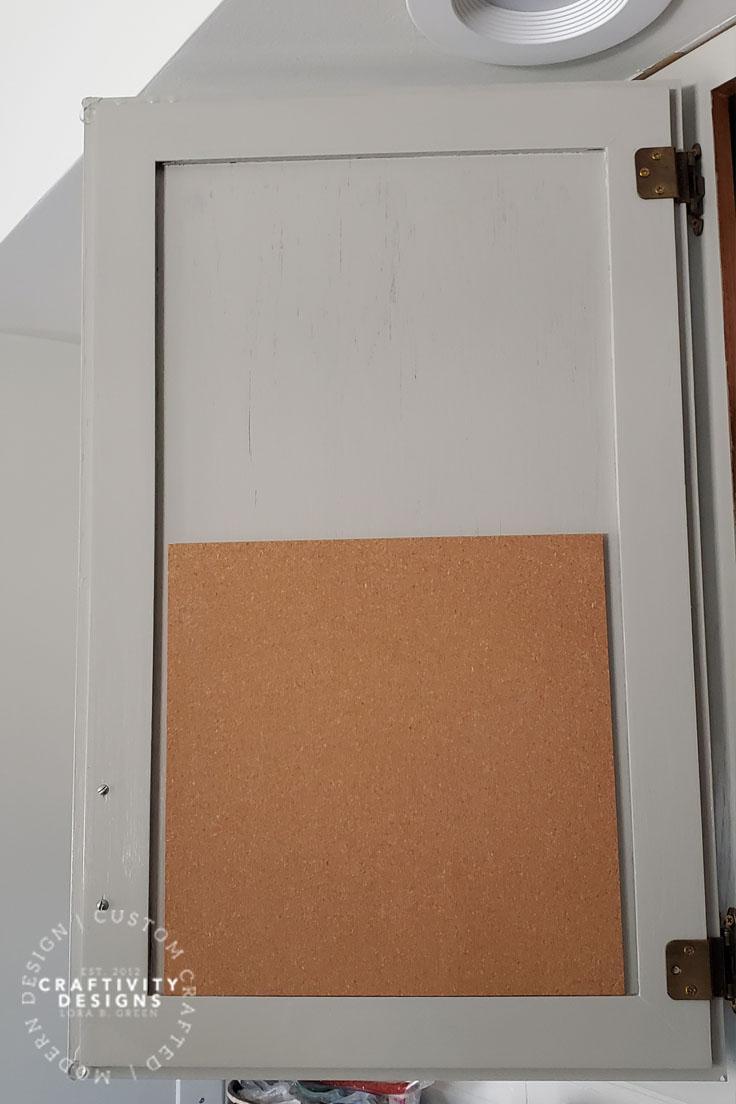 Corkboard Memo Board inside Kitchen Cabinet by Craftivity Designs