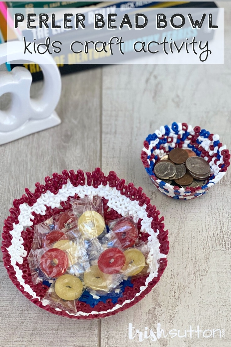 Perler Bead Bowl Kids Craft Activity - two bead bowls on a wood surface with candy pieces and coins in the perler bead bowls