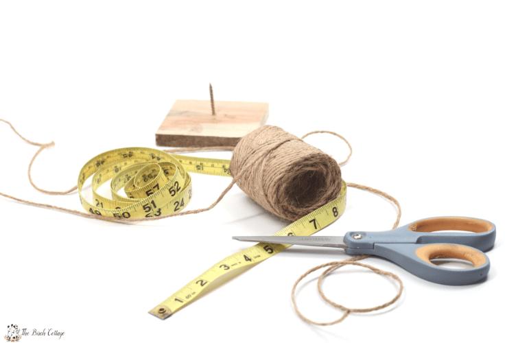 tape measure, spool of twine and scissors
