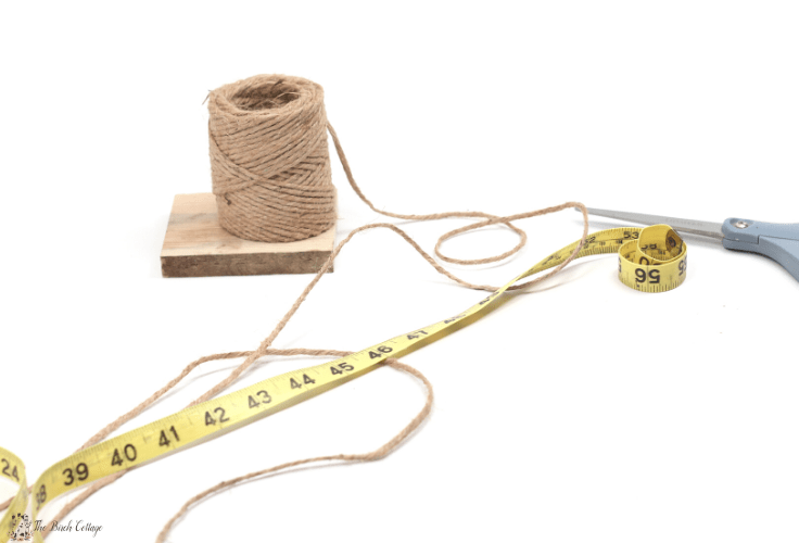 tape measure, scissors and spool of twine