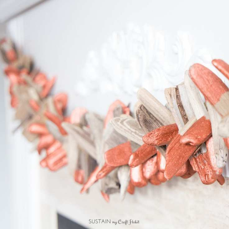 A homemade garland made out of copper-dipped driftwood.