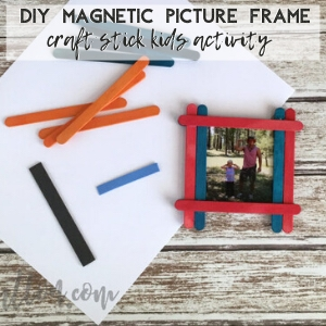 scattered craft sticks & magnetic craft picture frame on a wood surface