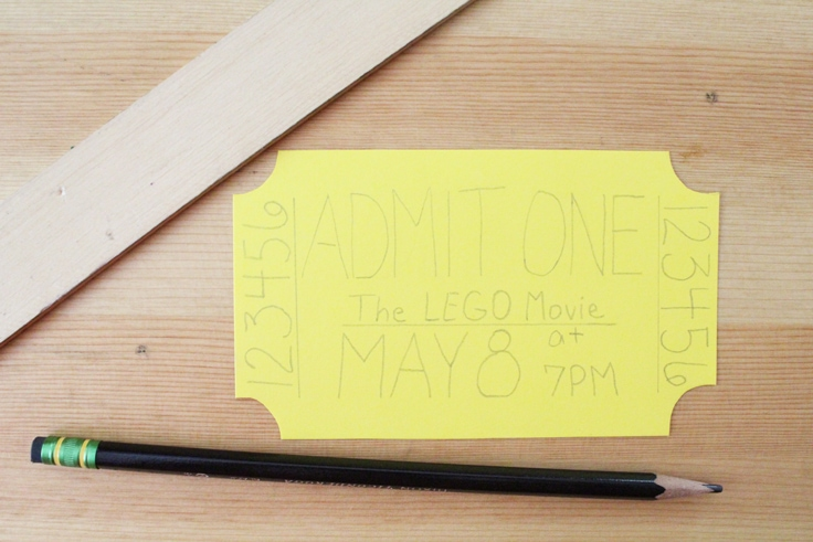 yellow paper movie ticket with movie details written in pencil