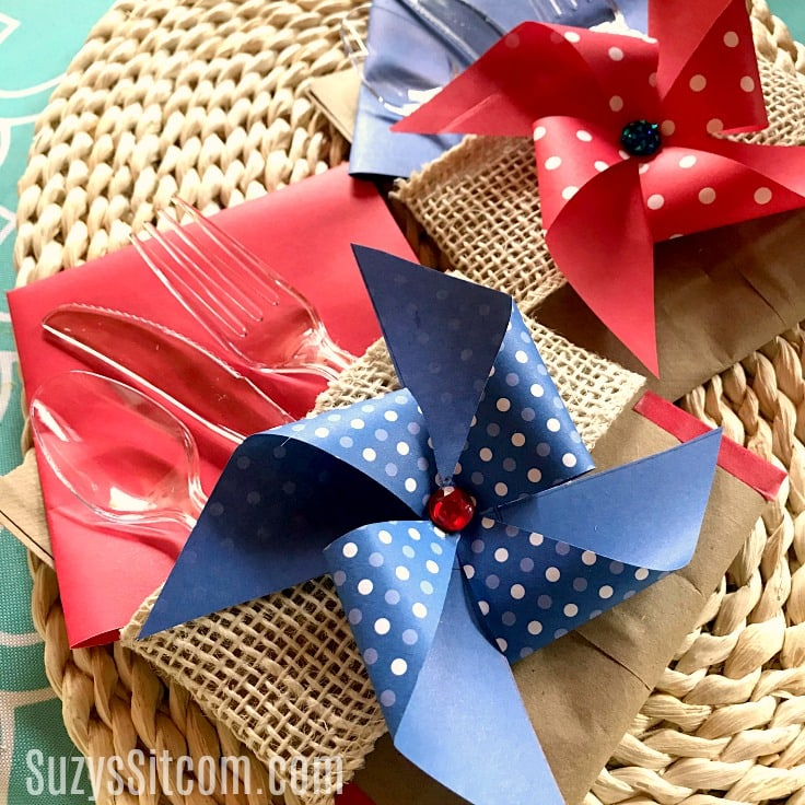 Pinwheels and burlap ribbon on utensil holders