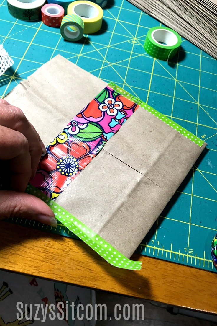 Adding washi tape to the paper bag