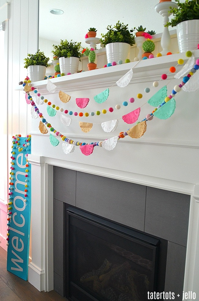 A garland made out of doilies and felt wool balls