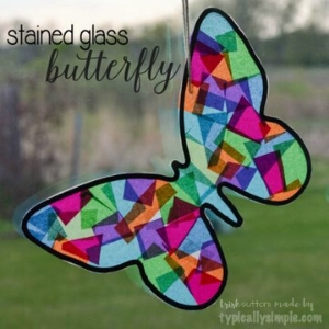 butterfly shape made out of tissue paper on a window