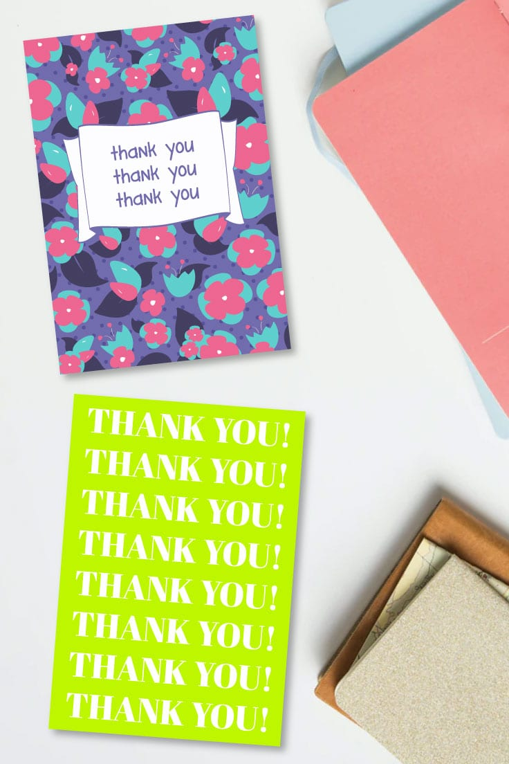 Preview of two printable thank you card designs on desk with journals.