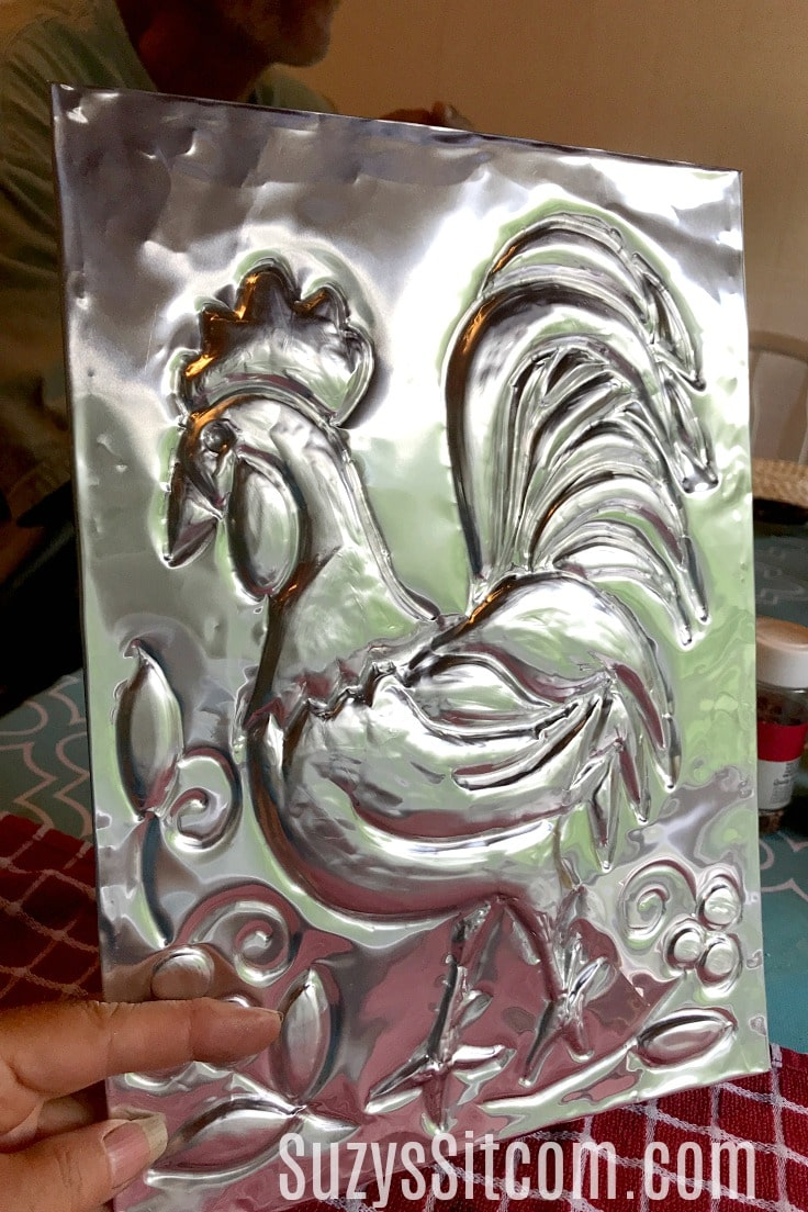 An embossed sheet of aluminum in the shape of a rooster