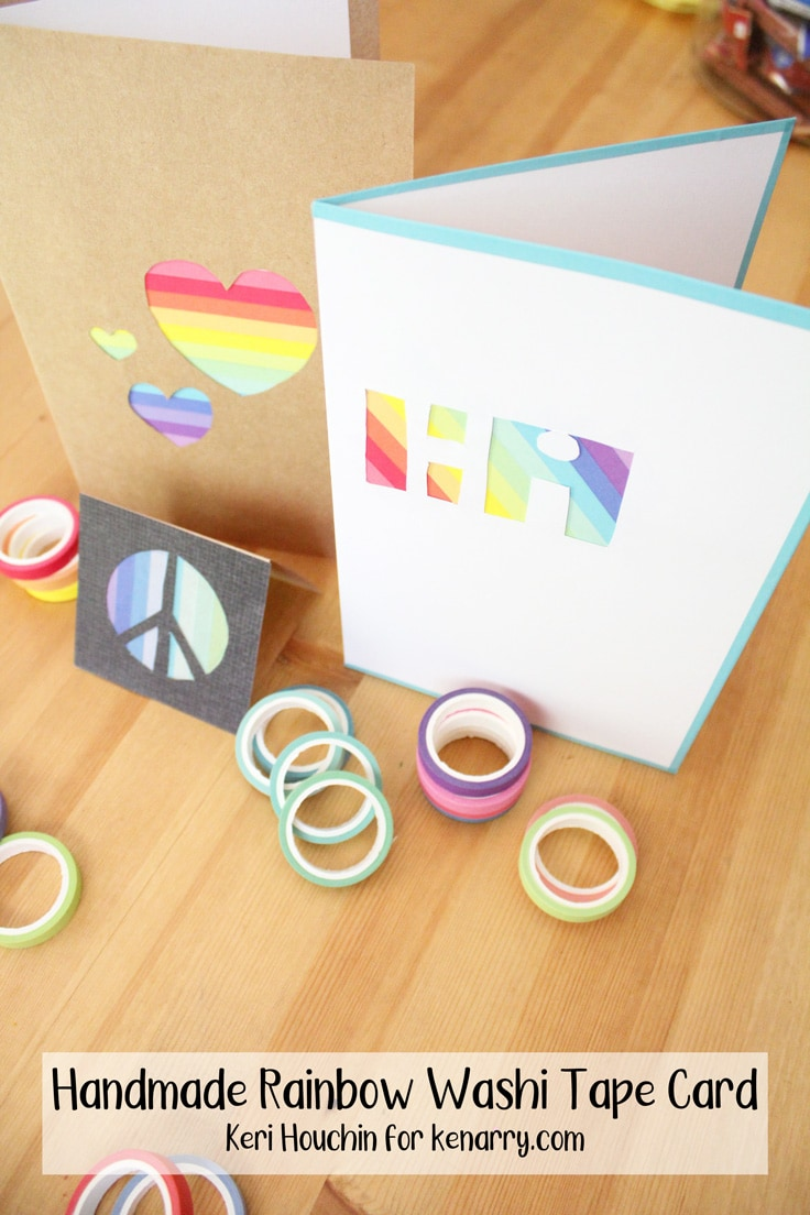 3 handmade rainbow washi tape cards sit on a wooden counter with rolls of colorful tape