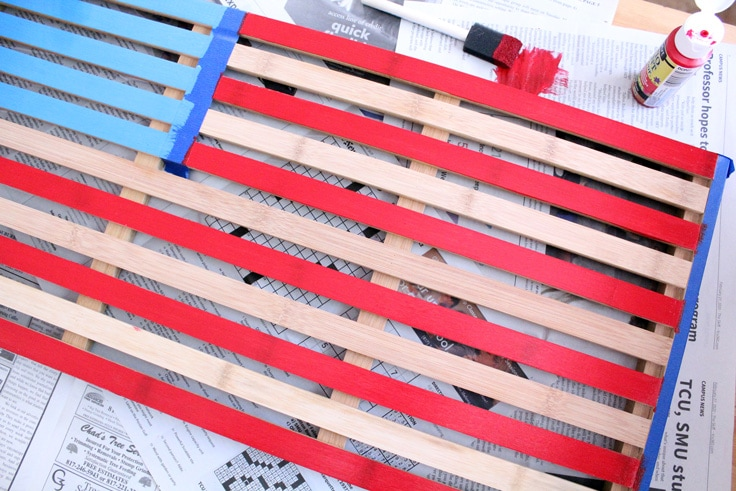 wooden mat with alternating slats painted red or left natural