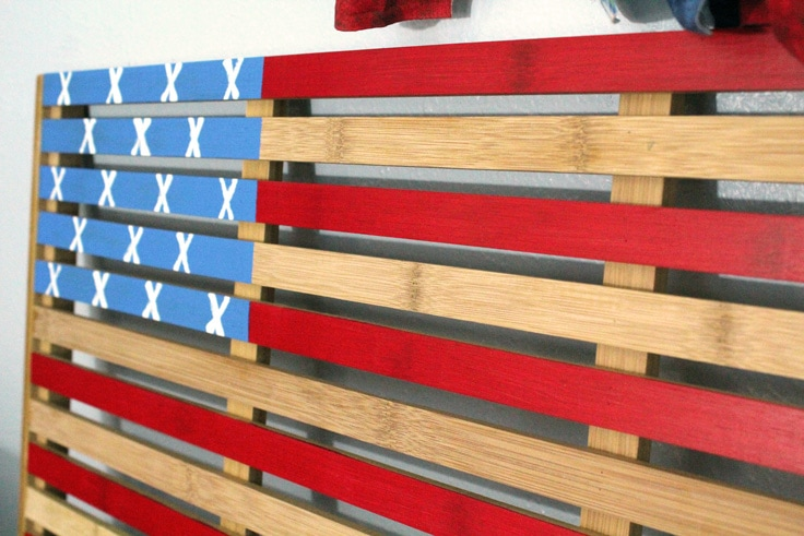 wooden welcome mat painted to resemble the American flag for July 4th decor