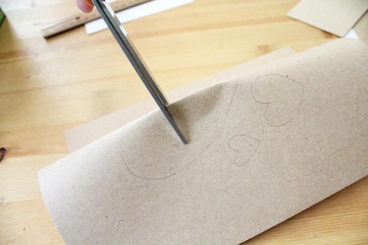 scissors cut into a bent piece of craft paper