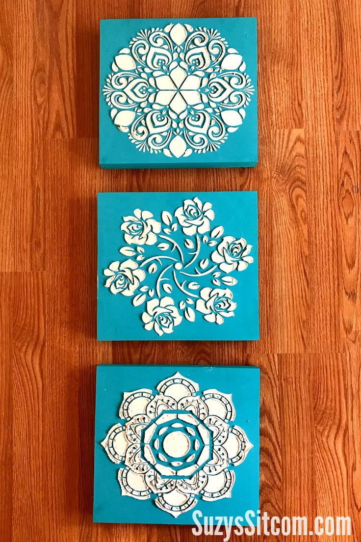 3 blue blocks with textured art made from stencils