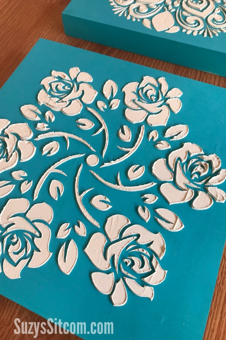 Floral textured art on blue canvas