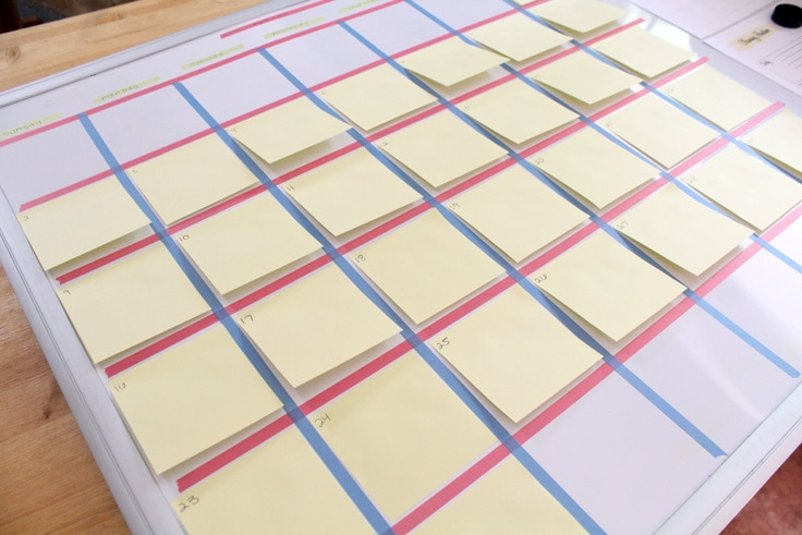 washi tape calendar filled with yellow sticky notes