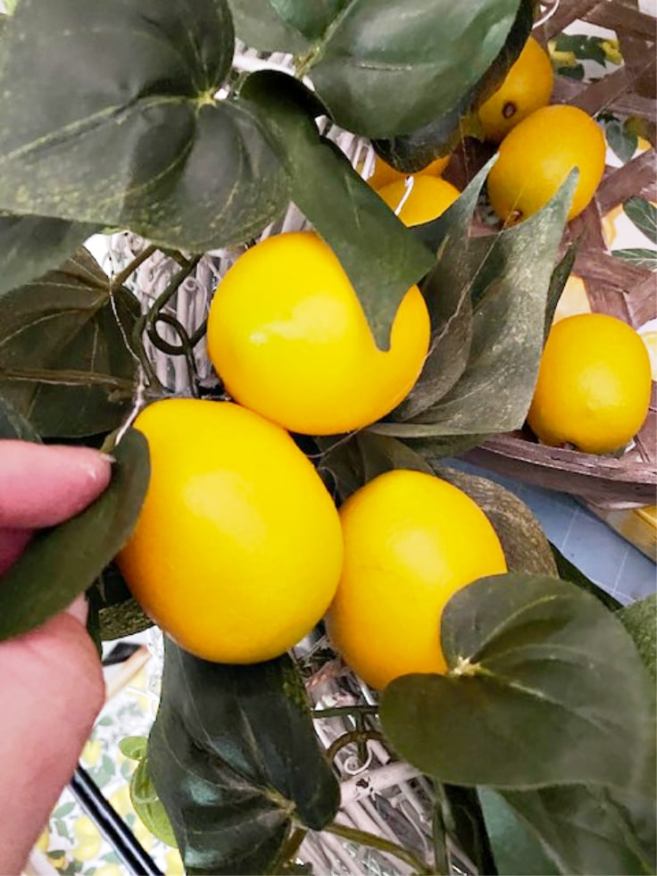 lemons added to garland wreath with hot glue