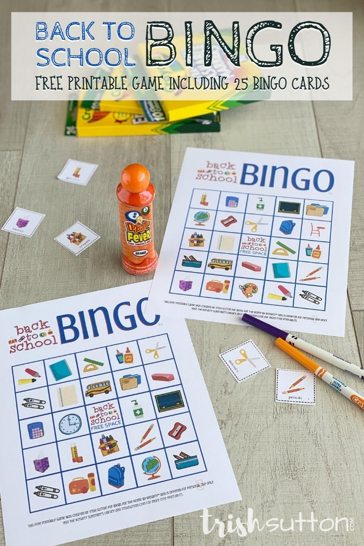 Back to School Bingo cards with markers and an orange dauber on a wood background.