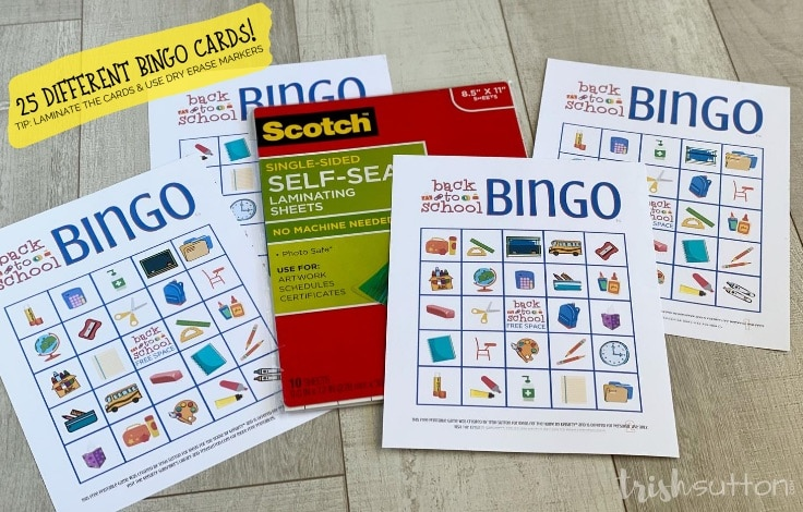 Back to School Bingo Game cards & instructions on a wood background.
