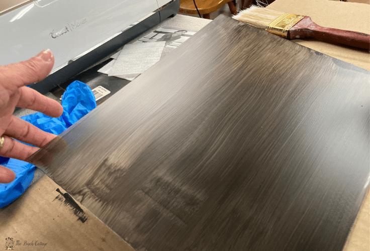 Applying chalkboard paint to wood.