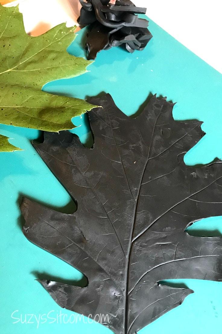 A black polymer clay leaf