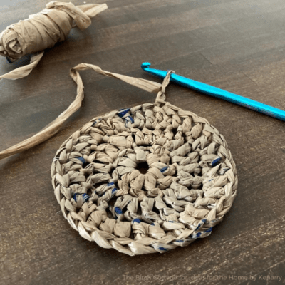 Plarn (or plastic yarn) is an eco-friendly way to turn plastic shopping bags into other useful items like this plarn coaster.