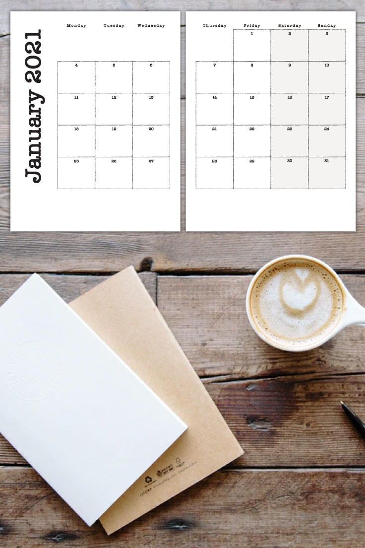 Preview of January 2021 monthly calendar on two pages on wooden desktop with view of a cup of coffee and writing journals.