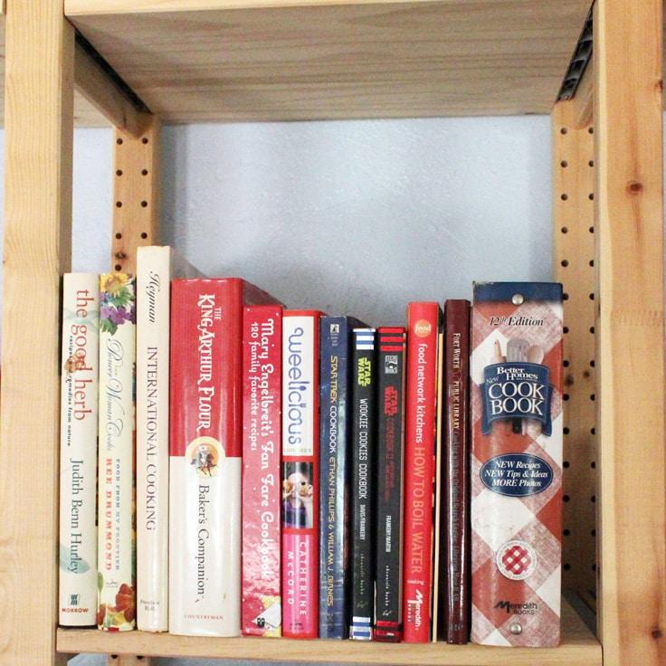organized cookbooks on a kitchen shelf