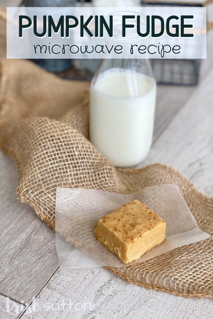A piece of Pumpkin Fudge resting on burlap with a bottle of milk in the background.