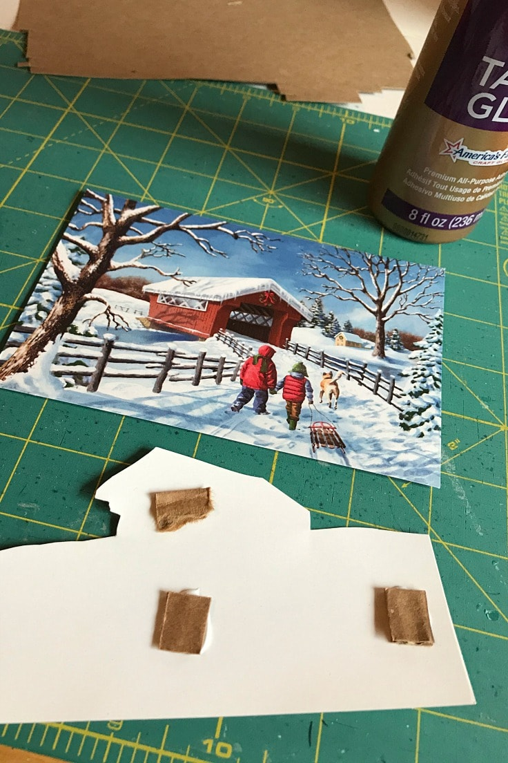gluing cardboard scraps to the back of a paper - this gives it depth for 3D layered paper art