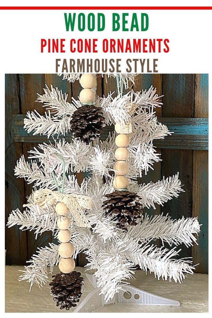 wood bead pinecone Christmas ornaments on white tree
