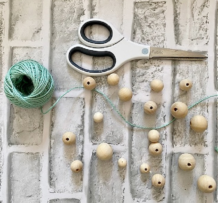wood beads and twine with scissors