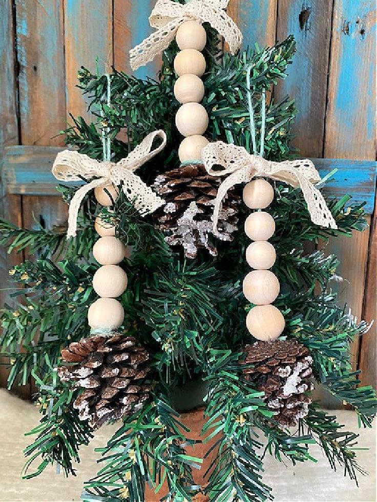 Wood bead pine cone ornaments on tree