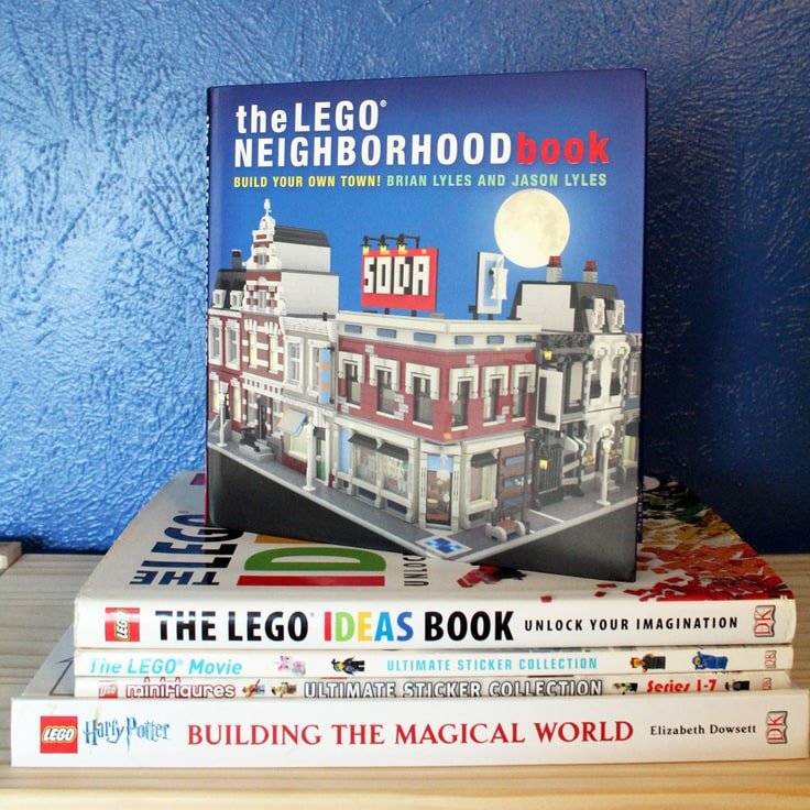 stack of family favorite LEGO books on a shelf