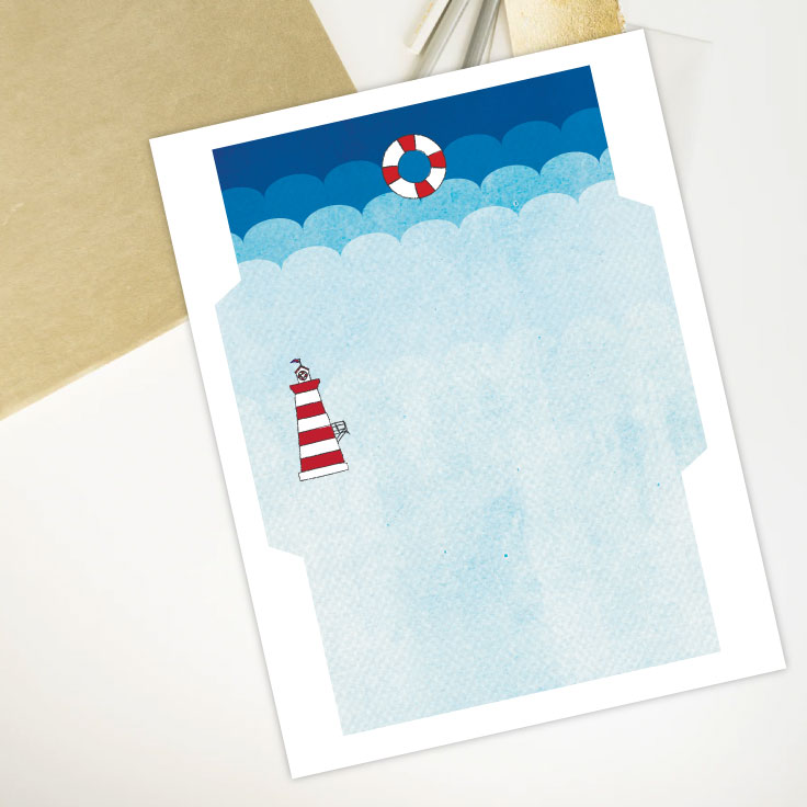 Preview of envelope template printable with lighthouse design on desk with notebook and pencils.