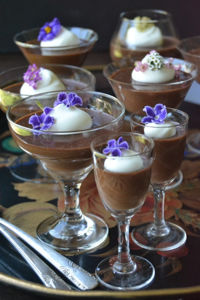 Dark chocolate pots de creme in glasses topped with flowers