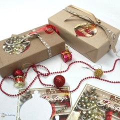 Gifts wrapped in brown paper with gift tags cut from recycled Christmas cards