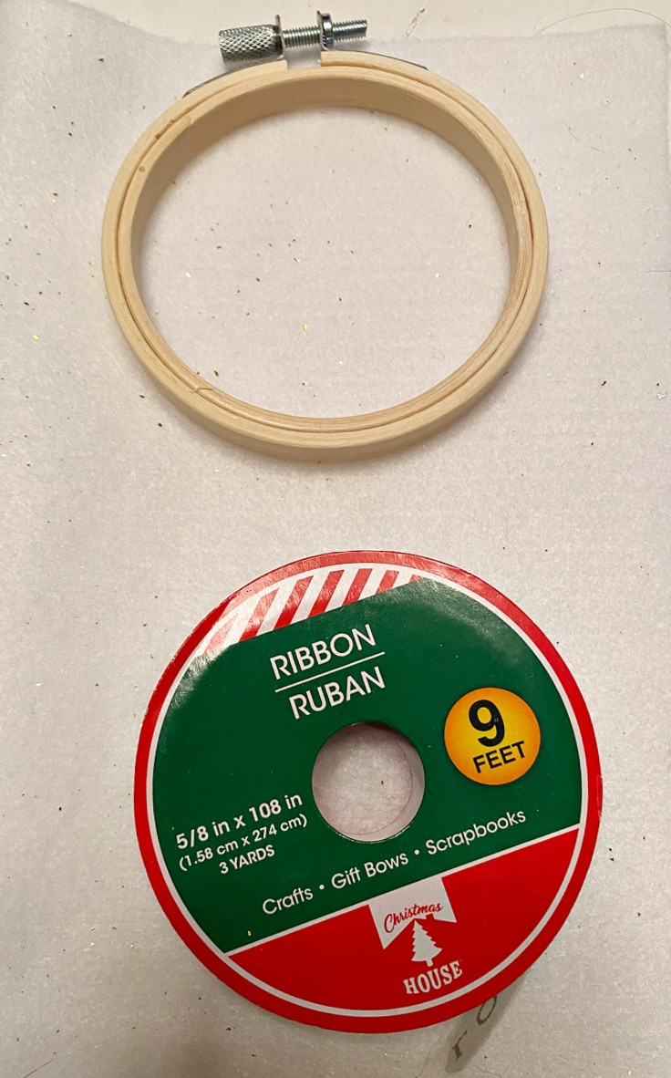 embroidery hoop ornament supplies include a small wooden hoop and ribbon