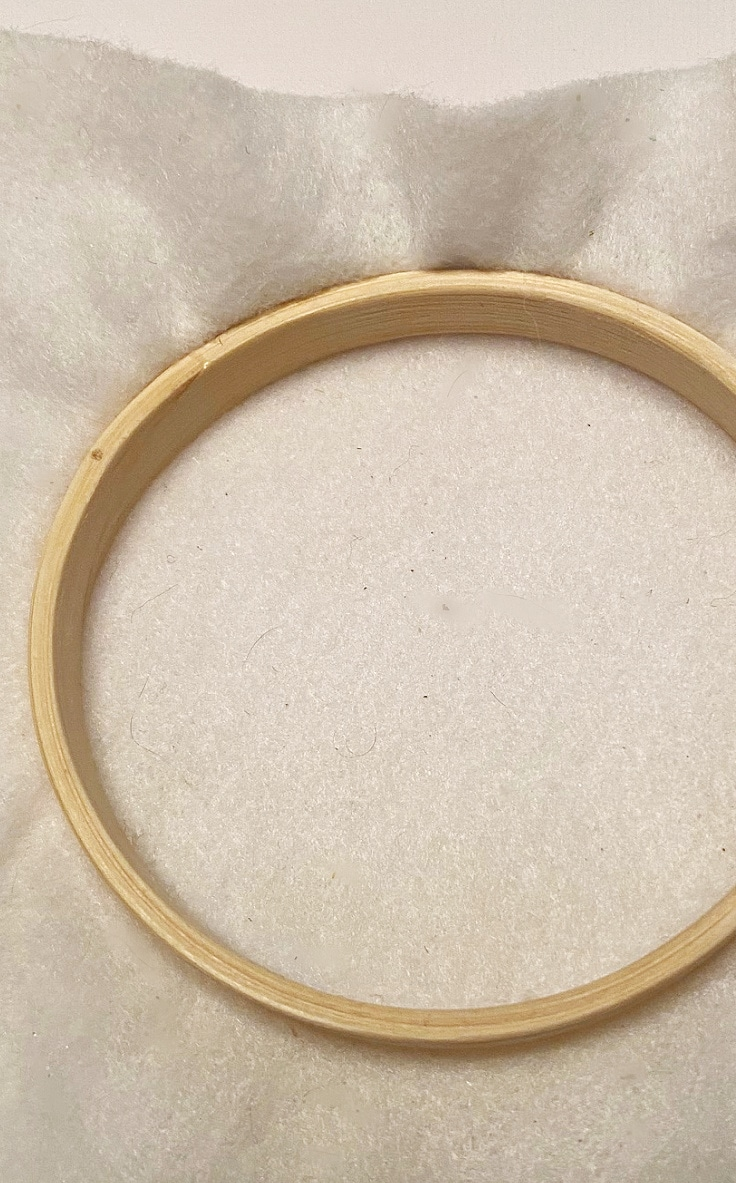 white felt in a wooden embroidery hoop