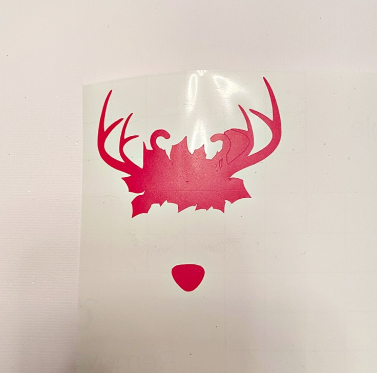A SVG reindeer design printed in red on vinyl