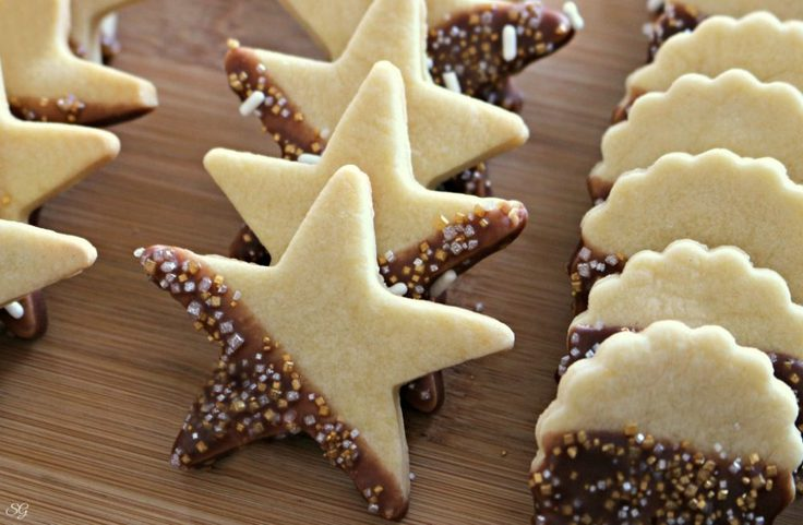 New Year's Eve cookies shaped like stars and circles dipped in chocolate and sprinkles